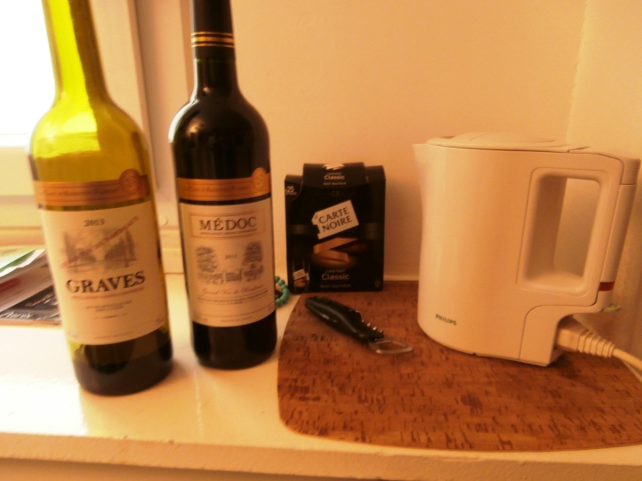 The truth is out -- Nescafe instant and a hot water pot -- plus some not bad $5 wine.