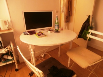 The table is smaller than it appears. The TV works great (French of course) but I haven't had time to watch it ...