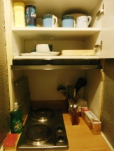 The stove, which I haven't used, and the open cabinet door ...