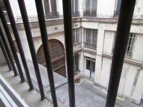 This is the actual courtyard I look out on -- the one where the entryway is, is far nicer. No sun ever penetrates here since there are at least four floors above me.